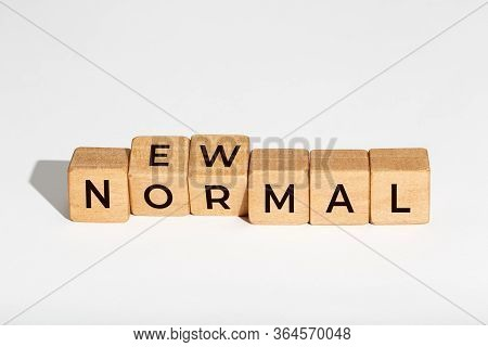 New Normal Concept. Wooden Dices With Text Isolated On White Background. Copy Space