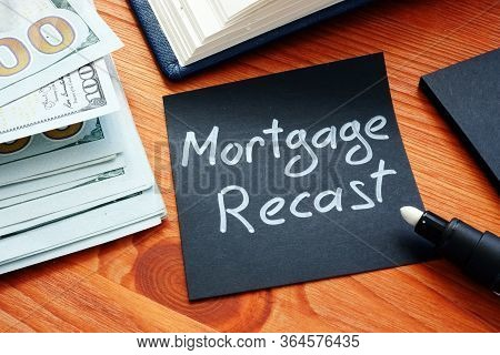 Mortgage Recast Memo With Money On The Surface.