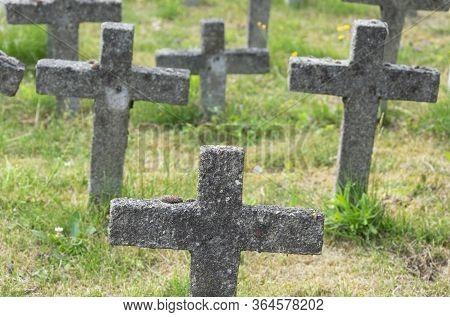 Sint Gillis Waas, Belgium, 8 July 2019, Concrete Crosses In An Old Graveyard