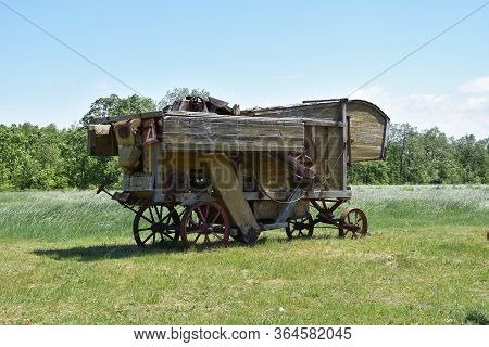 Antique Threshing Machine Used By Farmers In Rural Part Of Country
