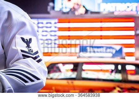 MAY 22 2019-NEW YORK: U.S. Navy sailors in uniform in Times Square during Fleet Week in Manhattan on May 22, 2019.