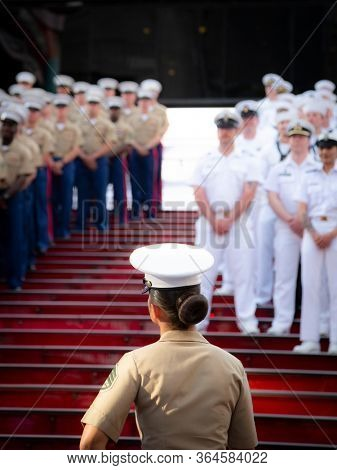 MAY 22 2019-NEW YORK: Marines  and Sailors gather for a group photo on the iconic red steps in Father Duffy Square during Fleet Week in Manhattan on May 22, 2019.