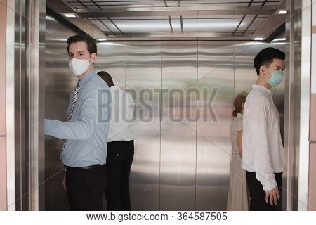 Social Distancing On Elevator With Passenger Stand In The Corner From Outbreak Of Coronavirus Covid1