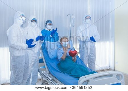 Sucessful Recovering Patient Resting On Bed Hold Mini Heart During Covid-19 Outbreak.
