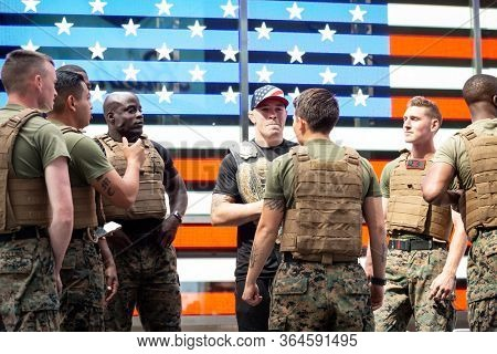 MAY 24 2019-NEW YORK: American mixed martial artist champion Colby Covington in a staring contest with a U.S. Marine at the Armed Forces Recruiting Station in Times Square, Fleet Week on May 24, 2019.