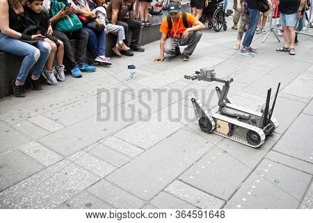 MAY 24 2019-NEW YORK: US Navy demonstration of a small unmanned ground vehicle used to locate and dispose of explosive devices at the Military Island Plaza in Times Square, Fleet Week on May 24, 2019.