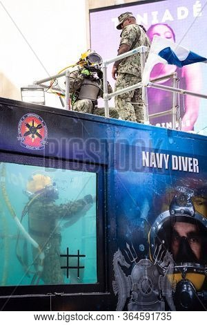 MAY 24 2019-NEW YORK: Underwater US Navy EOD technicians emerge from the 6,800 gallon mobile dive tank at the Military Island Plaza in Times Square during Fleet Week on May 24, 2019.