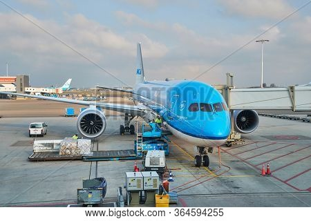AMSTERDAM, THE NETHERLANDS - MAY 15, 2019: Cargo loaded into a KLM Boeing 787 Dreamliner aircraft at Amsterdam Schipol International Airport