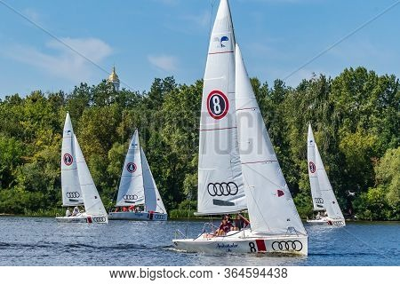 Kyiv Ukraine, The Dnieper River August 25, 2019. Sails, Sun, Air, Water And Sand. People Sail On Yac