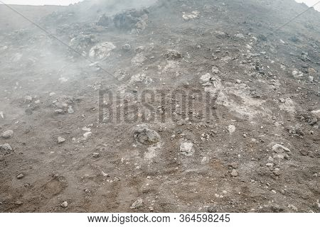 Top Of Crater Mount Etna Volcano, Frozen Cold Lava Smokes, Thick Clouds