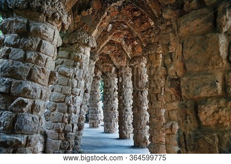Stone Walkway. Park Guell is one of the architecture masterpieces of Antoni Gaudi in Barcelona, Spain.