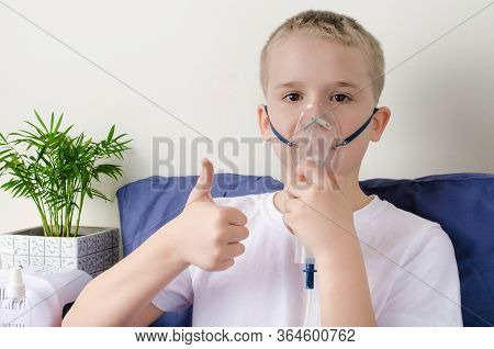 Sick Boy Breathing Through Inhaler Mask. Use Of Nebulizer And Inhaler For Treatment Or Respiratory D