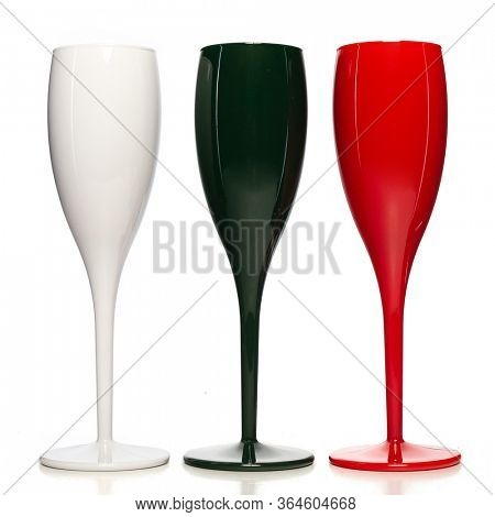 Realistic champagne glasses. Three mulricolored champagne glasses  for gourmets. Isolated glass cup on wite background for festive events