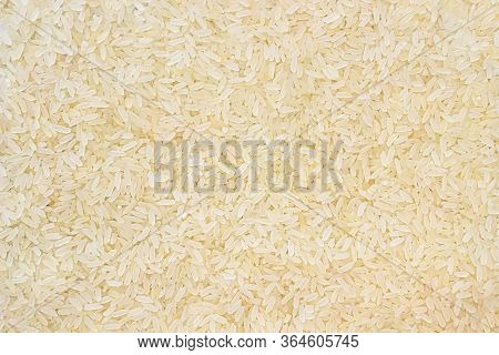 Layer Of Rice Grits. Food Background Of Long-grain Rice. Texture.
