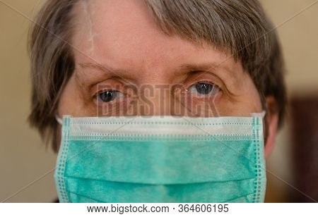An Elderly Woman In A Medical Mask In Quarantine And Self-isolation, Protecting The Elderly From Vir