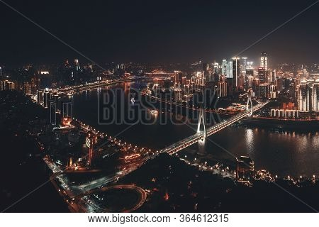 Chongqing urban architecture and city skyline at night in China