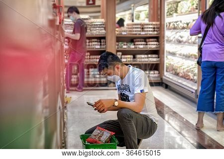 Bangkok, Thailand - May 02: Bangkok, Thailand - May 02: Unnamed Man Shops At Foodland Supermarket Wi