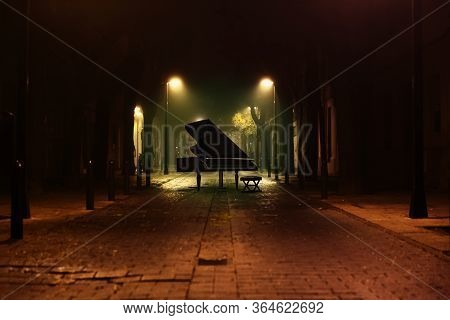 Piano Music Background.grand Piano In The Street Of The City At Night With Street Lamps And Cobblest