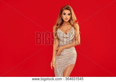 Sexy Blonde Lady In Elegant Dress.