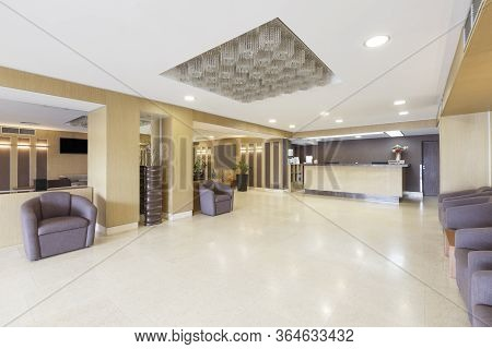 Empty Interior Of Hotel Hall With Reception Desk, Free Space