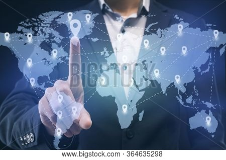 Businessman Touching Location On Worldwide Business Map Proected On Interactive Screen, Worldwide Bu