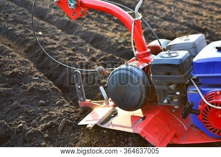 Farmer In A Field With Rototiller , Tiller Tractor