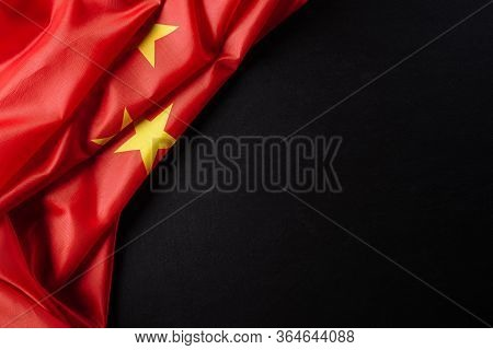 Top View Flag Of The Peoples Republic Of China With Copy Space On Black Background.
