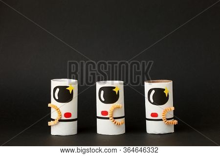 Toys Astronaut On Black Background With Copy Space For Text. Concept Of Business Launch, Start Up, H