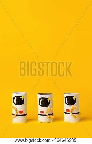 Toys Astronaut On Yellow Background With Copy Space For Text. Concept Of Business Launch, Start Up,