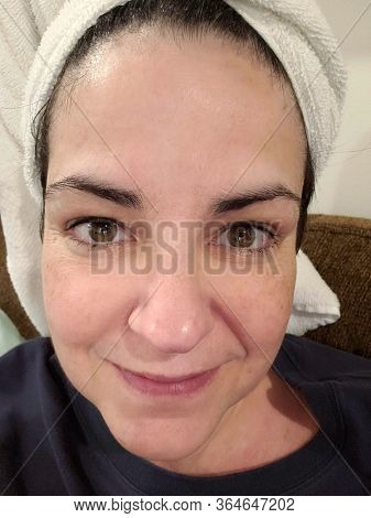 Overweight 54 Year Old Woman with Towel On Head No Makeup On.