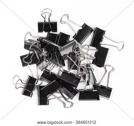 Stationery metal binder clips isolated on white background. Paper clips tool for paper documents clamping. Office metal foldback braces.