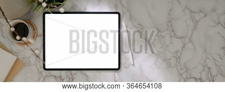 Top View Of Modern Worktable With Mock-up Tablet, Supplies, Decoration And Copy Space