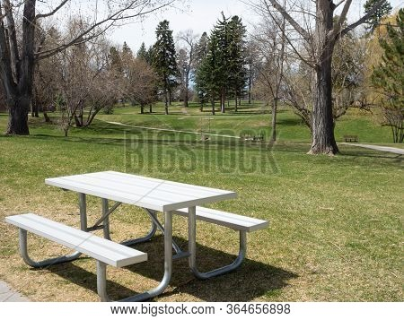 Unused Picnic Table In An Empty City Park During Covid-19 Pandemic.