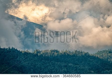 Amazing Nature, Summer Sunset Landscape. Mountainside With Green Forest And Dramatic Cloudy Sky. Sun
