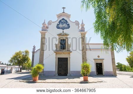 Exterior Of The Saint Lawrence Of Rome Church In Almancil, Portugal.