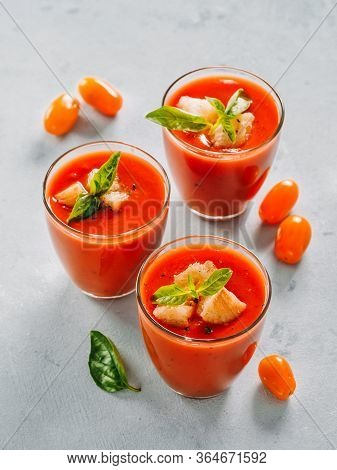 Delicious Gaspacho Soup In Glass. Traditional Spanish Cold Soup Puree Gaspacho Or Gazpacho On Gray C