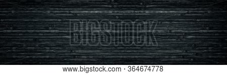 Black Wood Wide Texture. Bamboo Planks. Dark Long Background