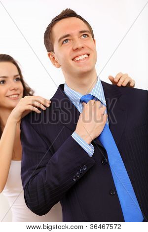 Businessman dressing at home in the morning