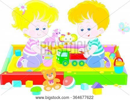 Happy Small Children Friendly Smiling, Romping And Playing With Their Colorful Toys In A Sandbox On