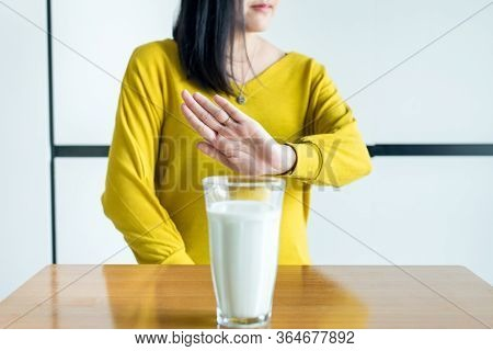 Woman Hands Refusing A Glass Of Milk,female Having Allergy Milk,lactose Intolerance Concept