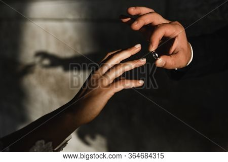 Man Proposes A Woman To Marry,close-up Of The Hand Of The Groom Who Dresses The Wedding Ring On The