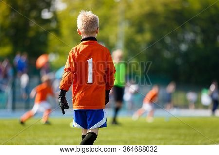 Boy Soccer Goalkeeper On The Field. Young Football Goalie On Kids Sports Competition. Junior Level S