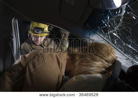Male firefighter trying to open car's door