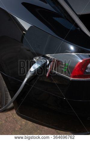 Bordeaux , Aquitaine / France - 03 30 2020 : Tesla Car Charging Electric Vehicle Ve Supercharger Rea