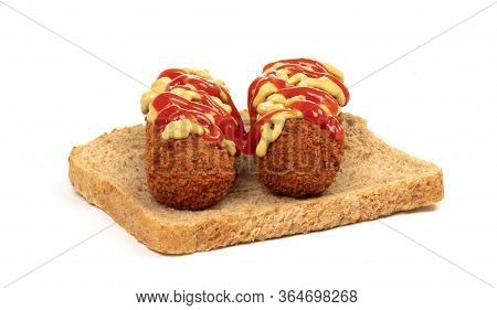 Brown Crusty Dutch Kroket With Mustard Topping Isolated, On A Piece Of Bread, On A White Background