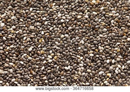 Chia Seeds Close-up Background Macro. The Texture Of The Chia Seeds. Copy Space. Flat Lay. Healthy F