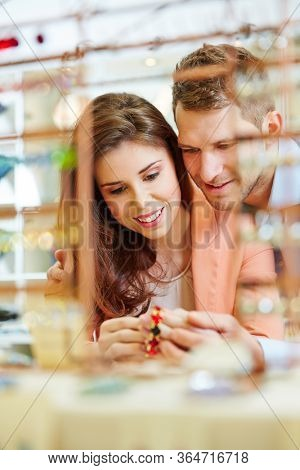 Smiling couple buying jewelry at jewelry store