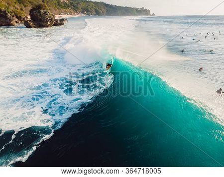 Aerial View Of Surfer At Barrel Wave. Blue Waves And Surfers In Ocean
