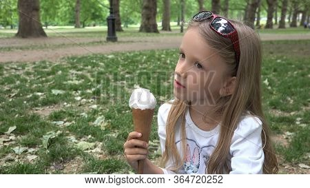 Girl In London Park, Kid Eating Ice Cream, Child Resting On Grass By Buckingham