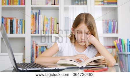 Kid Reading A Book In Library, Child Learning, Writing For Homework School, Schoolgirl Studying From